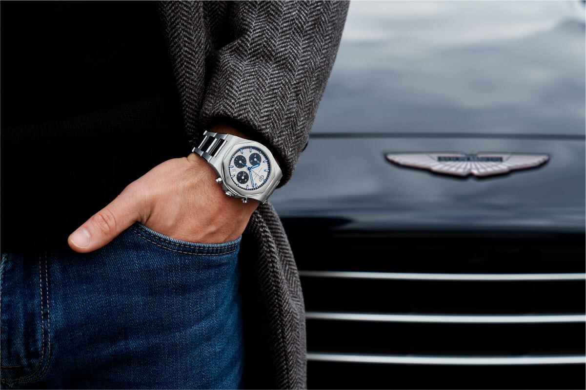 Pulso com Girard-Perregaux e imagem da grelha de um Aston Martin
